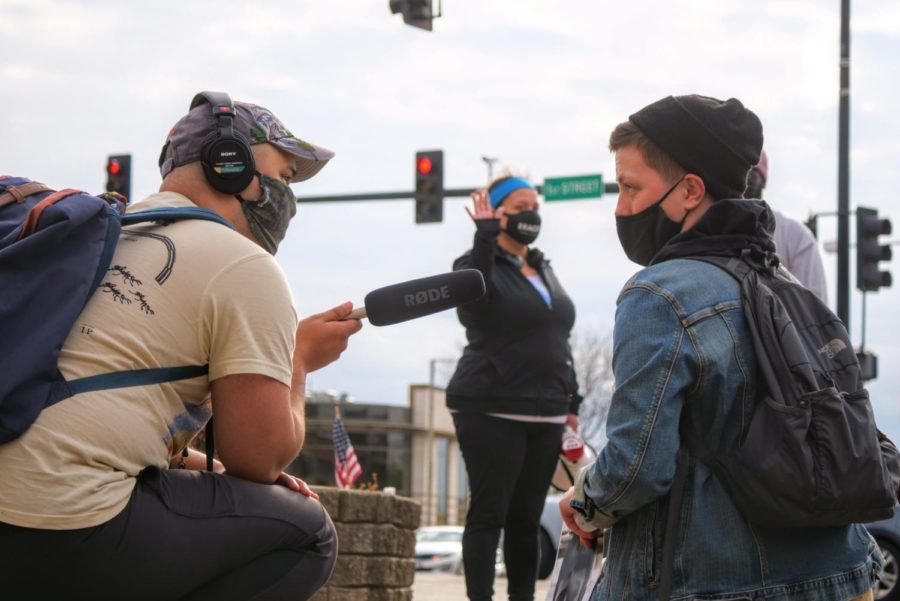 Jane Pappas answers questions during an interview with a reporter Friday at a vigil in Memorial Park.