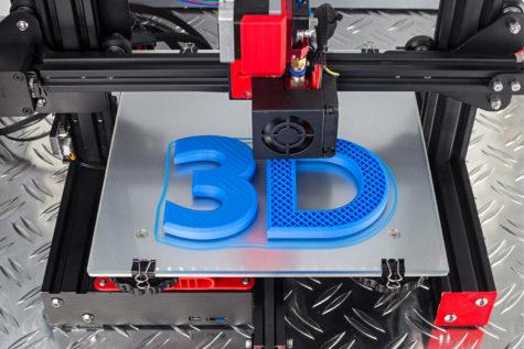 Red black 3D printer printing blue logo symbol on metal diamond plate future technology modern concept background