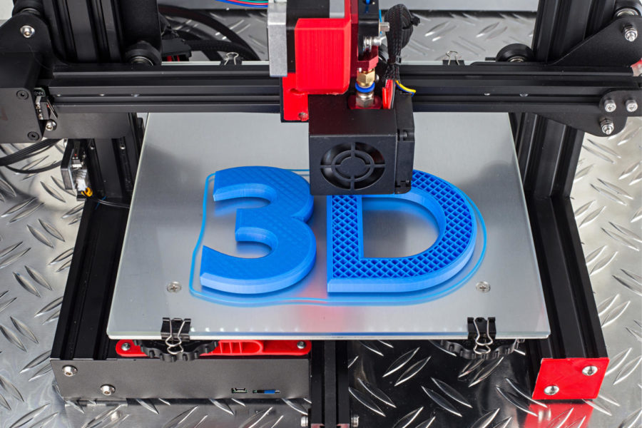 Red black 3D printer printing blue logo symbol on metal diamond plate future technology modern concept background