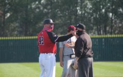 NIU head baseball coach Mike Kunigonis has a discussion with an umpire during an April 3 game against the Central Michigan Chippewas at Ralph McKinzie Field.