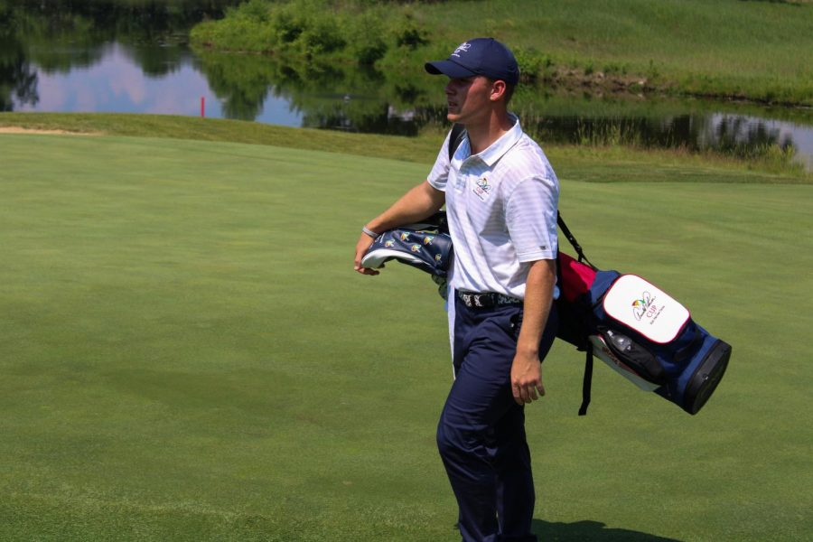 Team USA competitor Brad Reeves approaches a green Friday, during the mixed fourball session of the Arnold Palmer Cup at Rich Harvest Farms in Sugar Grove.