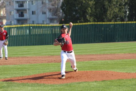 NIU freshman pitcher Conner Langreder throws a pitch at an April 3 game against the Central Michigan University Chippewas in DeKalb. Langreder threw 10 strikeouts in the season finale on Sunday.