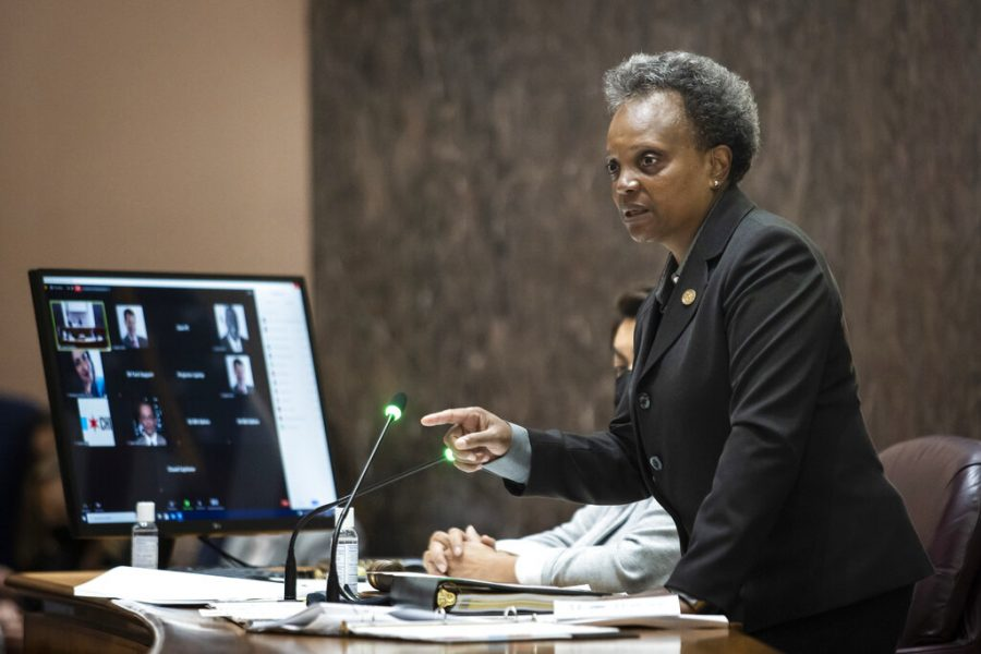 Mayor Lori Lightfoot discusses a proposal for civilian oversight of the Chicago Police Department during a Chicago City Council meeting at City Hall, Wednesday, July 21, 2021. The ordinance to give civilians more oversight over the city's police department, a step intended to help restore public trust between citizens and police, passed by a 36-to-13 vote. (Ashlee Rezin/Chicago Sun-Times via AP)
