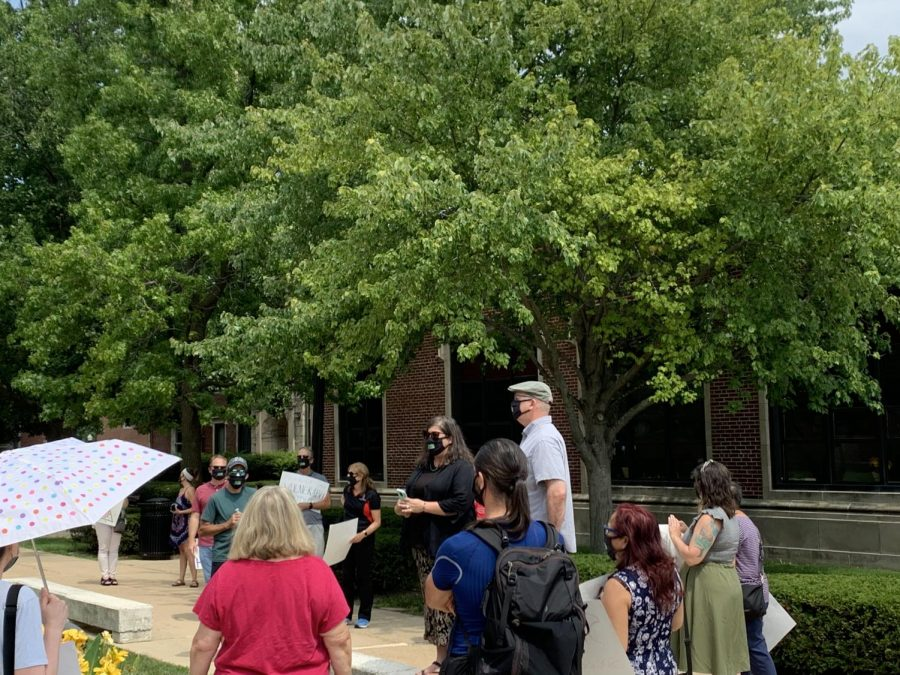 Kerry Ferris, president of the tenured faculty union, and Keith Nyquist, president of the non-tenured faculty union, thank NIU employees for rallying on Friday.
