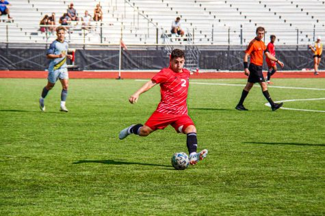 Senior midfielder Adrian Corona launches a pass in NIUs Aug. 26 win over Purdue-Fort Wayne. NIU now sits at 1-1 after a 2-0 loss to the Notre Dame Fighting Irish.