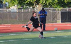 Senior goalkeeper Julia Lentz executes a goal kick during women's soccer practice on Aug. 17. NIU begins their season Thursday against the University of Milwaukee.