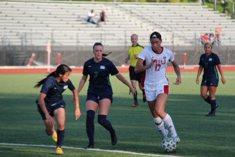 Graduate student forward Haley Hoppe dribbles the ball in a game against Chicago State on Aug. 26. Hoppe's goal in the 11th minute was her third of the season.