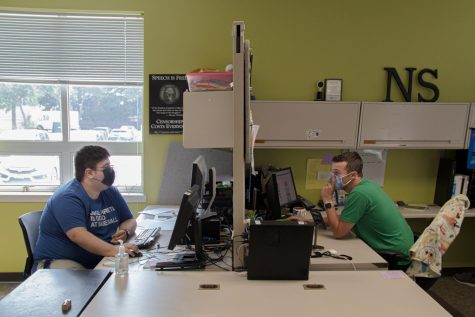 Paginator Jordan Radloff (left) and Editor-in-Chief Wes Sanderson work in the office on the 2021 Back-to-School print edition.
