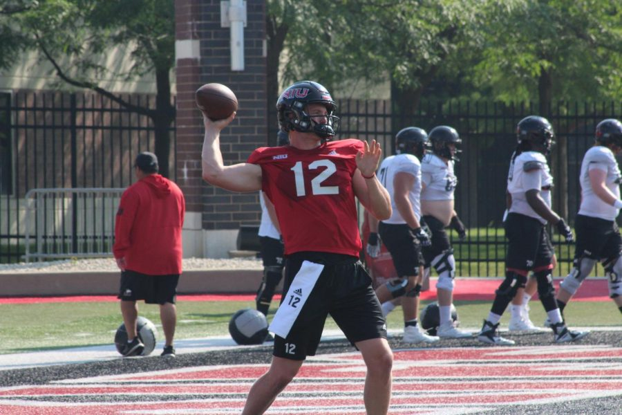 Junior quarterback Rocky Lombardi throws a pass in practice on Aug. 20. Lombardi transfers in from Michigan State University, where he threw eight touchdowns and nine interceptions last season.