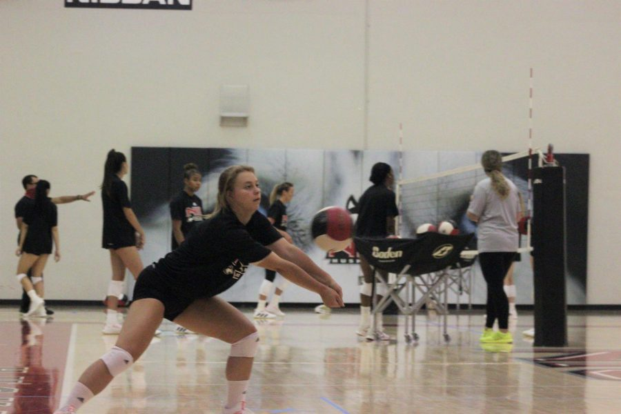 Redshirt senior libero Miranda Karlen digs in a practice on Aug. 24 at Victor E. Court. The Huskies will play three games over two days to open their regular season schedule.