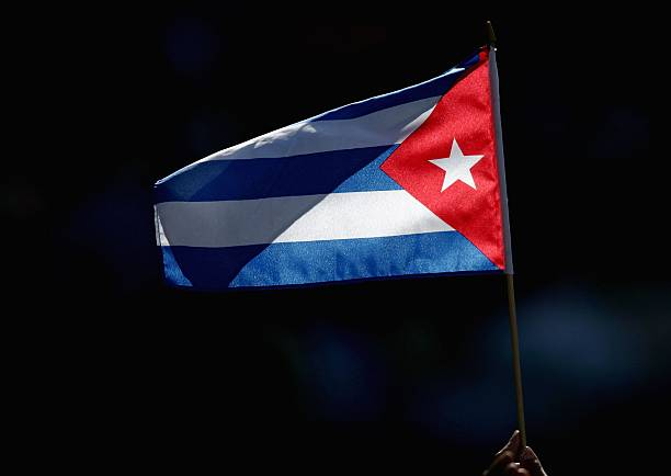 SAN DIEGO - MARCH 18:  A fan of Team Cuba waves a flag in celebration against Team Domincan Republic during the Semi Final game of the World Baseball Classic at Petco Park on March 18, 2006 in San Diego, California.   (Photo by Donald Miralle/Getty Images)