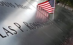 An American flag is placed on the World Trade Center memorial to honor one of the fallen from the Sept. 11 attacks.