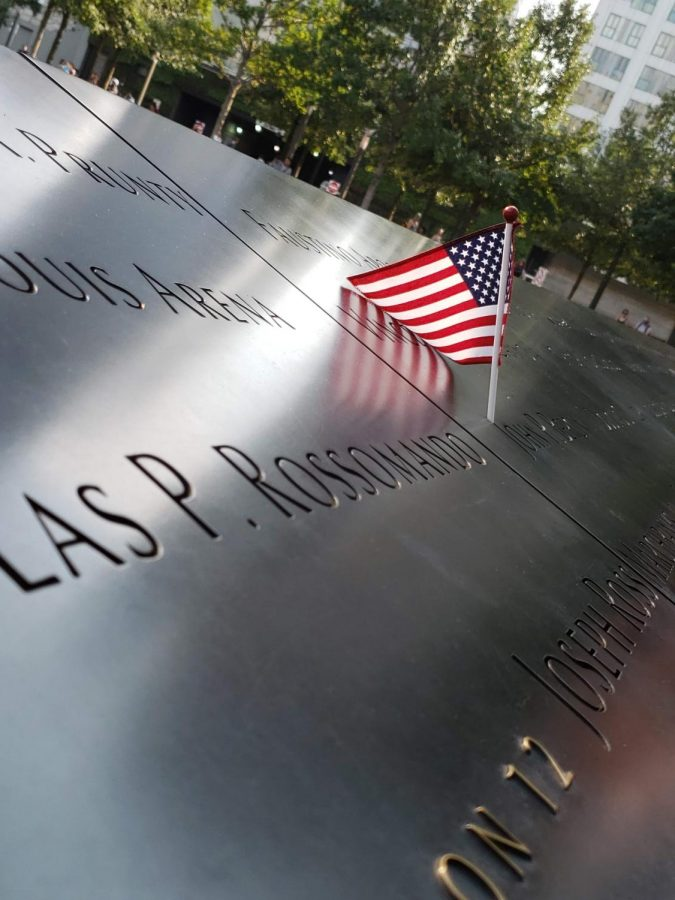 An+American+flag+is+placed+on+the+World+Trade+Center+memorial+to+honor+one+of+the+fallen+from+the+Sept.+11+attacks.
