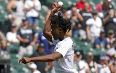 Chicago Bulls' Ayo Dosunmo throws out a ceremonial first pitch before a baseball game between the Chicago Cubs and the Chicago White Sox in Chicago, Sunday, Aug. 29, 2021. (AP Photo/Nam Y. Huh)