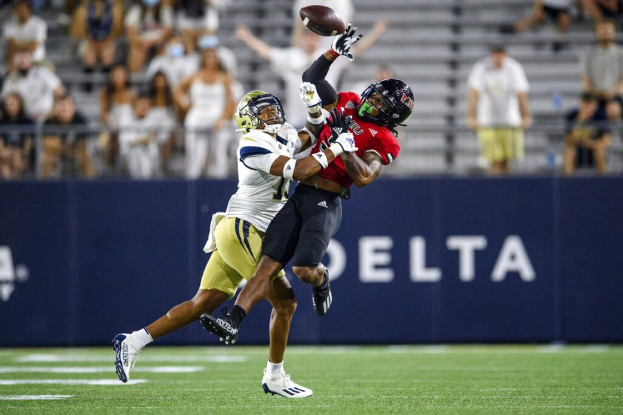 NIU wide receiver Tyrice Richie (3) catches a pass over Georgia Tech defensive back Wesley Walker (13) during the first half of the Huskies 22-21 victory over Georgia Tech on Sept. 4, 2021, in Atlanta.