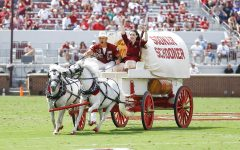 The Oklahoma Sooner Schooner makes it way across the field after an Oklahoma touchdown against Tulane during a NCAA college football game Saturday, Sept. 4, 2021, in Norman, Okla.