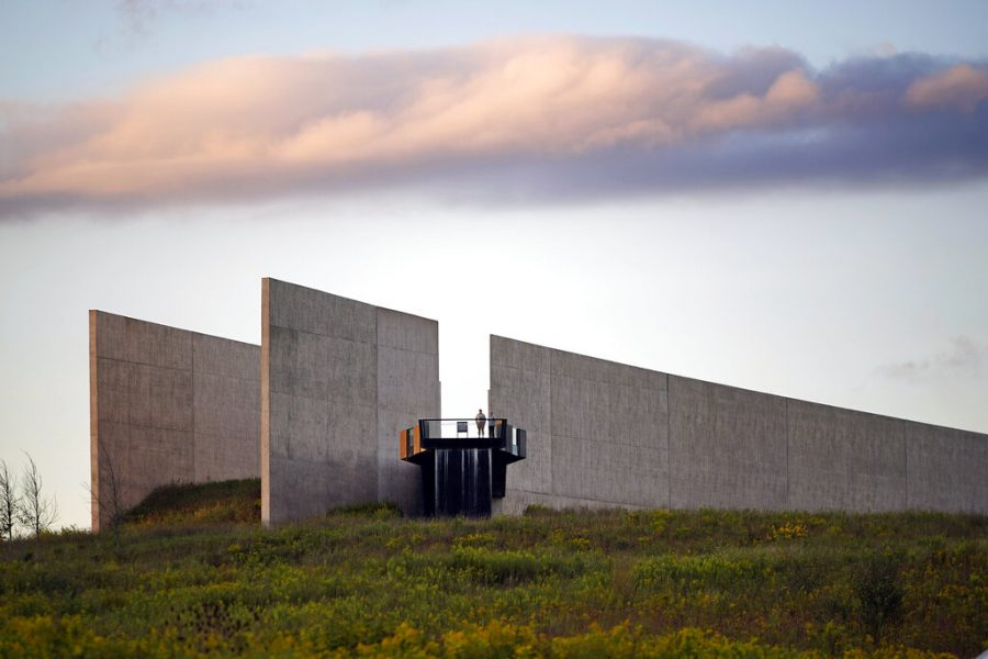 A visitor to the Flight 93 National Memorial visitor center, in Shanksville, Pa, stand on an observation platform overlooking the crash site of Flight 93 at sunset Friday, Sept. 10, 2021, as the nation prepares to mark the 20th anniversary of the Sept. 11, 2001 attacks.