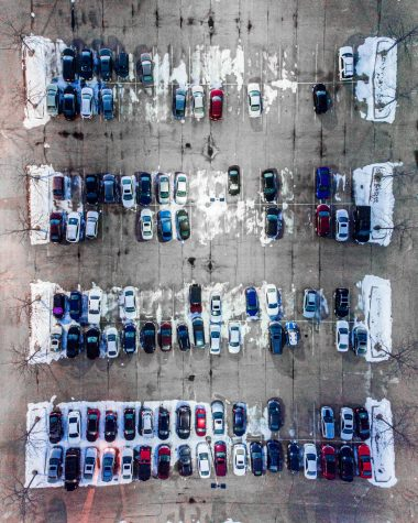 A parking lot with a few spaces left for drivers to park in.
