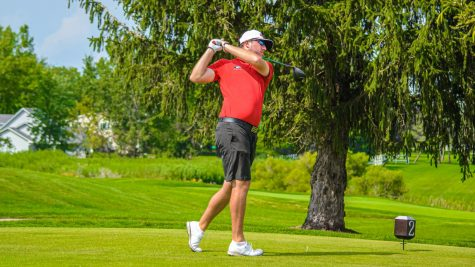 Senior Reece Nilsen hits a tee-shot during a tournament qualifying round at Rich Harvest Farms in Sugar Grove. Nilsen claimed solo second, Monday at the Badger Invitational in Verona, Wis.