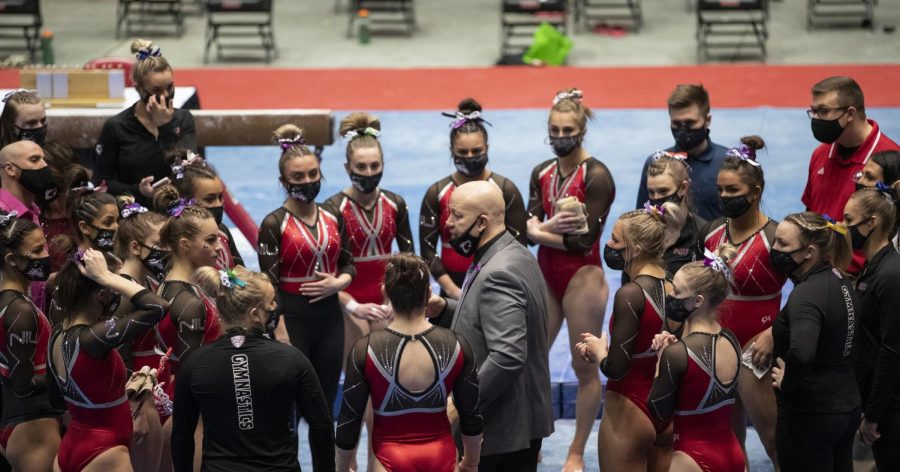 Head+gymnastics+coach+Sam+Morreale+talks+to+his+team+during+a+meet+in+the+2021+season.+The+Huskies+were+named+the+best+academic+team+in+the+country+by+the+WCGA.