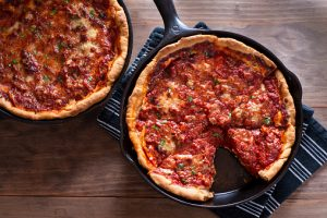 Chicago-style deep dish pizza in a cast Iron skillets.