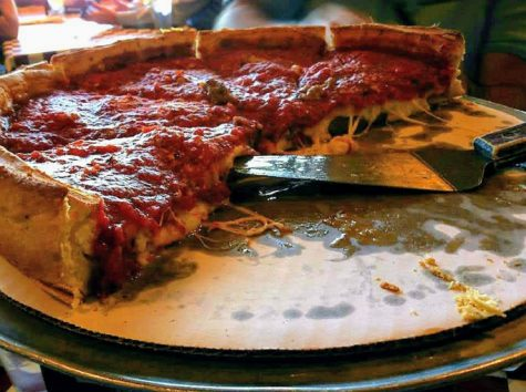 A half-finished Chicago deep dish pizza.