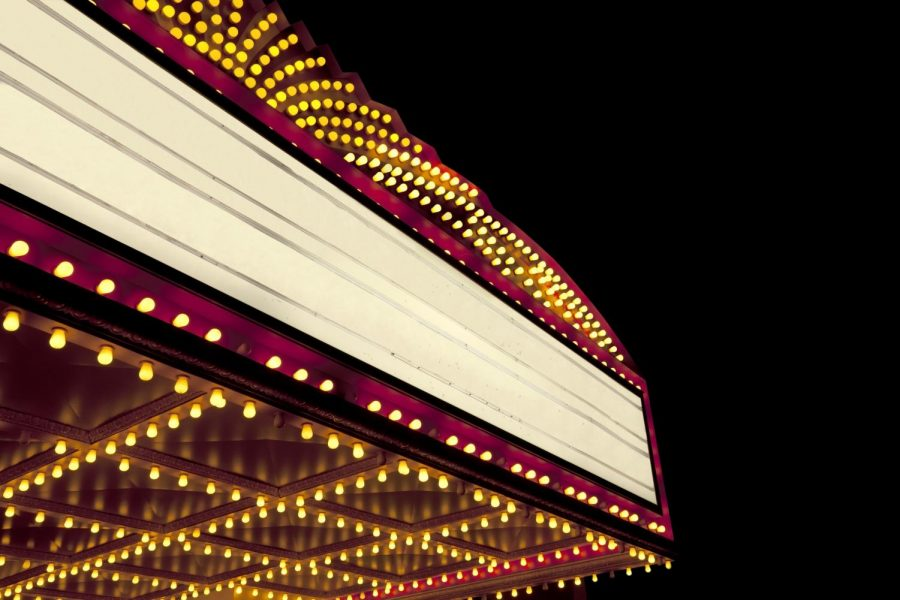 Lighted theater marquee at night.