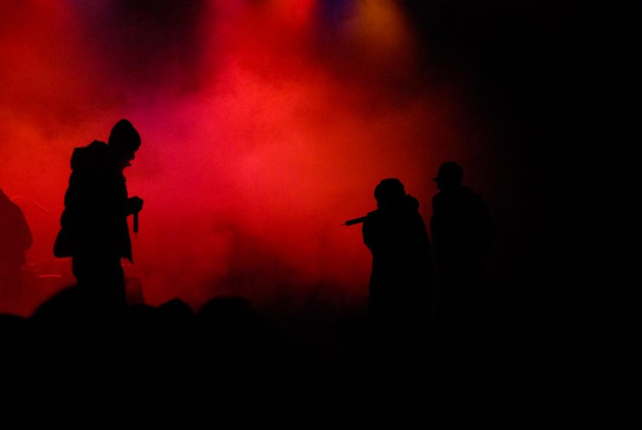 Rappers performing at a concert.