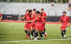 The mens soccer team celebrates a goal by redshirt junior  Enrique Banuelos (middle, 9) on Aug. 26. Banuelos scored in NIUs 3-0 victory over Chicago State that extended their winning streak to six games.