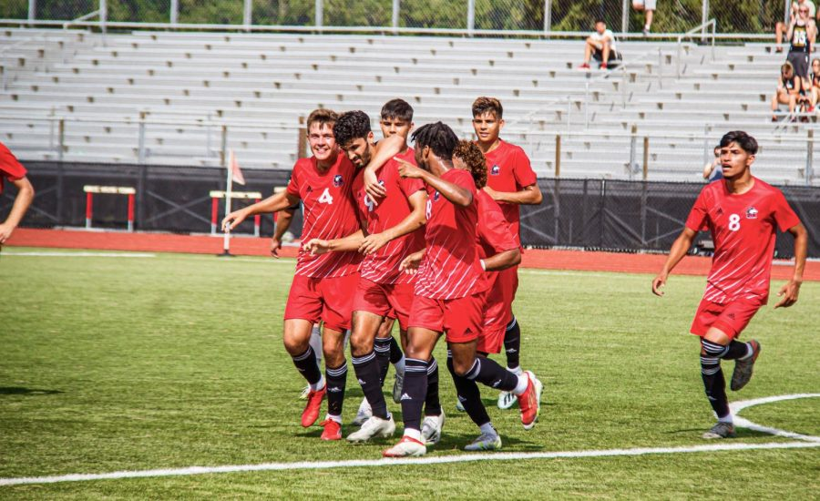 The+mens+soccer+team+celebrates+a+goal+by+redshirt+junior++Enrique+Banuelos+%28middle%2C+9%29+on+Aug.+26.+Banuelos+scored+in+NIUs+3-0+victory+over+Chicago+State+that+extended+their+winning+streak+to+six+games.