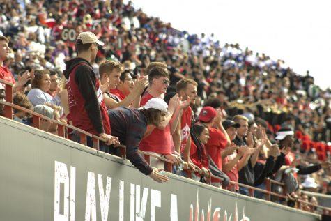 Fans cheer on the NIU football team on Sept. 25 at Huskie Stadium.