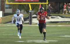 Junior quarterback Rocky Lombardi (right) runs with the ball with Maine sophomore defensive end Khairi Manns in pursuit. Lombardi scored on this play for his second of three rushing touchdowns.