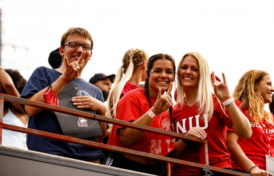 Fans throw up the Huskie symbol at Saturday's home opener between NIU and Wyoming. The reported attendance was 11,334.