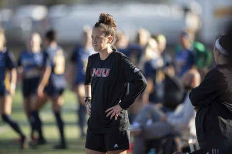 Head womens soccer coach Julie Colhoff watches her team from the sideline.