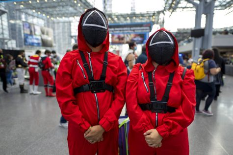 Attendees dressed as characters from Squid Game pose during New York Comic Con at the Jacob K. Javits Convention Center on Friday, Oct. 8, 2021, in New York.