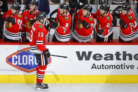 Chicago Blackhawks left wing Henrik Borgstrom (13) celebrates with teammates after scoring against the Minnesota Wild during the first period of an NHL preseason hockey game, Saturday, Oct. 9, 2021, in Chicago.