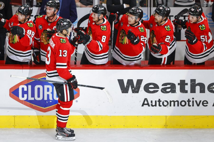 Chicago+Blackhawks+left+wing+Henrik+Borgstrom+%2813%29+celebrates+with+teammates+after+scoring+against+the+Minnesota+Wild+during+the+first+period+of+an+NHL+preseason+hockey+game%2C+Saturday%2C+Oct.+9%2C+2021%2C+in+Chicago.+