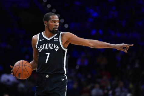 Brooklyn Nets Kevin Durant plays during a preseason NBA basketball game, Monday, Oct. 11, 2021, in Philadelphia.