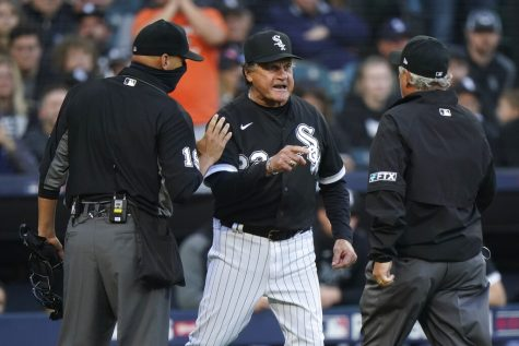 Chicago White Sox manager Tony La Russa argues with umpire Tom Hallion as home plate umpire Vic Carapazza tries to hold him back after Jose Abreu was hit by a pitch against the Houston Astros in the eighth inning during Game 4 of a baseball American League Division Series Tuesday, Oct. 12, 2021, in Chicago.