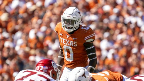Texas linebacker DeMarvion Overshown (0) waits for the snap during the first half of an NCAA college football game against Oklahoma at the Cotton Bowl, Saturday, Oct. 9, 2021, in Dallas. Oklahoma won 55-48.