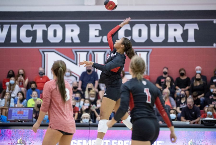 Freshman middle blocker Charli Atiemo sets to spike against Wisconsin on Sept. 18 at Victor E. Court.