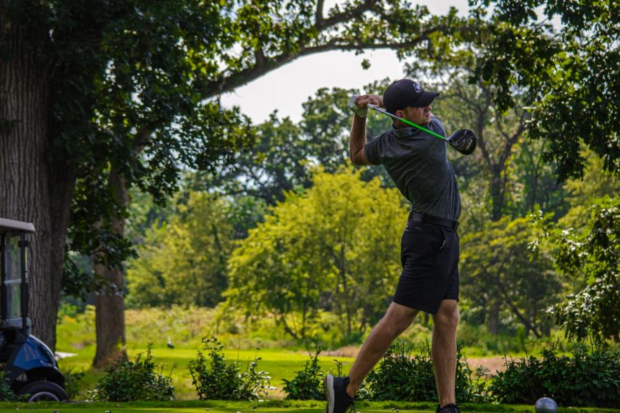 Senior Tommy Dunrise practices at Rich Harvest Farms on Aug. 28. Dunrise finished the first round tied with freshman teammate Ben Sluzas for first after shooting 67.