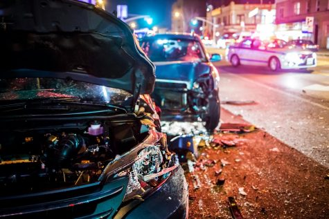 Two vehicles sit damaged after a crash.