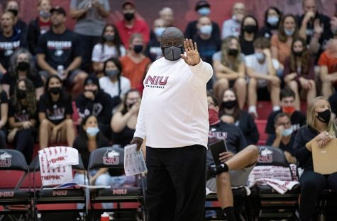 Head coach Ray Gooden coaches his team from the sidelines during a match on Sept. 18 at Victor E. Court. Gooden has coached at NIU for 20 years.