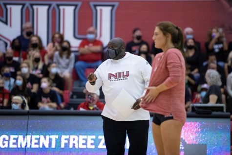 Head volleyball coach Ray Gooden coaches on his team during a Sept. 18 game against Wisconsin at Victor E. Court.