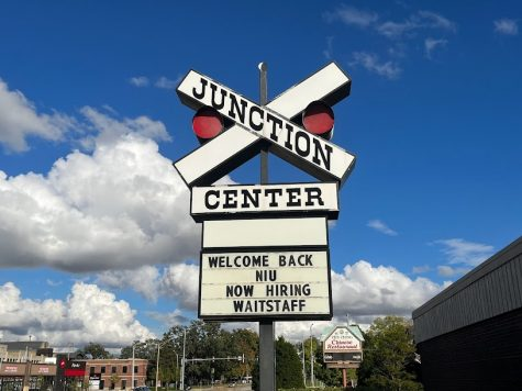 A now hiring sign at The Junction in DeKalb.