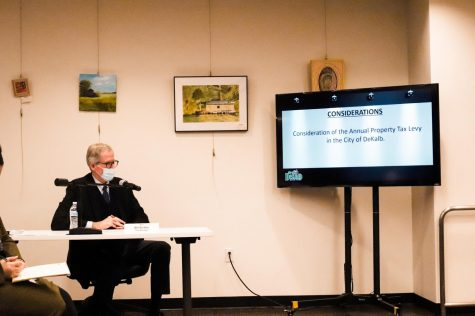 City Manager Bill Nicklas reads off the Oct. 25 City Council agenda to discuss the annual property tax levy.
