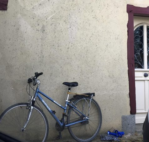 A bicycle leaning against a wall in Brittany, France.