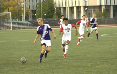 Sophomore midfielder Roland Dearborn chases down a Western Illinois defender during NIUs win over WIU on Sept. 18.