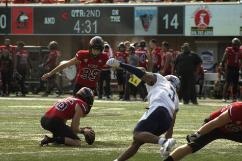 Redshirt sophomore John Richardson kicks a field goal in the second quarter against the University of Maine on Sept. 25. Richardson tied the school record of five made field goals in a game with his game-winning kick against Toledo on Oct. 9.